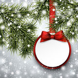 Paper gift card on spruce branches. Royalty Free Stock Photo