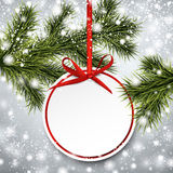 Paper gift card on spruce branches. Royalty Free Stock Image