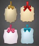 Paper gift cards with color satin bows. Royalty Free Stock Photos