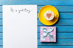 Paper, gift, coffee and laptop lying on the table Royalty Free Stock Image