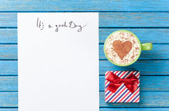 Paper, gift, coffee lying on the table royalty free stock photos