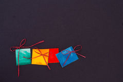 Paper gifts. On black background Royalty Free Stock Photos