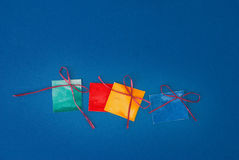 Paper gifts. On blue background Stock Photos