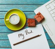 Paper, gifts, coffee and laptop lying on the table Royalty Free Stock Images