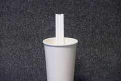 Paper glass with a paper straw royalty free stock photography