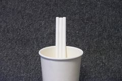 Paper glass with a paper straw stock photography