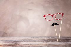 Paper glasses and moustache on color background. Father`s day celebration Stock Photography