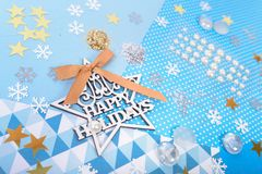 Paper and glitter for Christmas craft making. Paper, glitter and shiny accessories for Christmas craft making in white, blue and gold colors. Design for happy Royalty Free Stock Image
