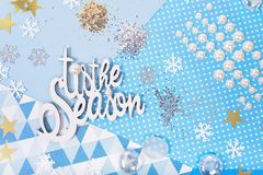 Paper and glitter for Christmas craft making. Paper, glitter and shiny accessories for Christmas craft making in white, blue and gold colors. Design for happy Stock Photography