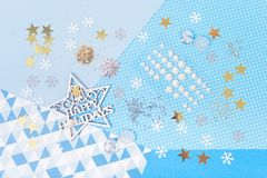 Paper and glitter for Christmas craft making. Paper, glitter and shiny accessories for Christmas craft making in white, blue and gold colors. Design for happy Stock Photo