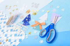 Paper and glitter for Christmas craft making. Paper, glitter and shiny accessories for Christmas craft making in white, blue and gold colors. Design for happy Stock Photos
