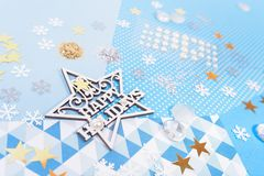 Paper and glitter for Christmas craft making. Paper, glitter and shiny accessories for Christmas craft making in white, blue and gold colors. Design for happy Royalty Free Stock Photo