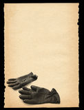 Paper with gloves motif Stock Image