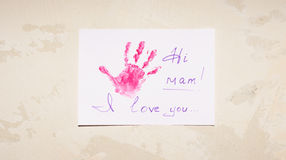 Paper glued on the wall. Imprint child hands on sheet of paper glued on the wall putty Stock Photography