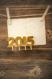 Paper and 2015 golden figures Royalty Free Stock Photos