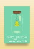 Paper green Christmas tree inside a glass jar Stock Image