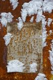 Paper on a grunge wall in snow Stock Photography