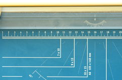 A paper guillotine, paper cutter with measuring features Stock Image