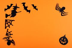 Paper halloween decoration on the orange background. stock images