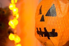 Paper Halloween pumpkin With Blurred yellow light in background Stock Photos