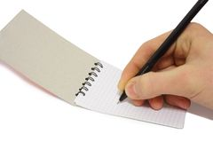 Paper in a hand. Noteboke and pen in a  hand Royalty Free Stock Photography