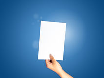 Paper hand holding on blue gradient. Background, business background Stock Photos