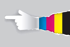 Paper Hand showing direction with print colors. Royalty Free Stock Photo