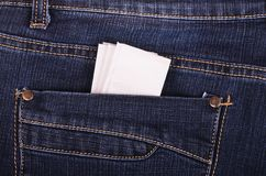 Paper handkerchief in the jeans pocket. Paper handkerchief in the blue jeans pocket Royalty Free Stock Photography