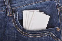 Paper handkerchief in the jeans pocket. Paper handkerchief in the blue jeans front pocket Stock Image