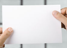 Paper in  hands Royalty Free Stock Photos
