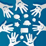 Paper hands with faces and bubbles speech. Paper hands with happy faces and bubbles speech Stock Photography