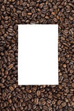 Paper on heap of coffee beans. Piece of paper on heap of coffee beans Royalty Free Stock Images