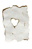 Paper Heart. An isolation of a burned piece of paper with a heart at the center Stock Photography