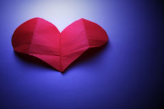 Paper heart. Red paper heart unfolded on the blue background Royalty Free Stock Images