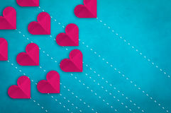 Paper heart array on light blue leather background Stock Photography