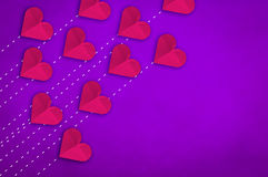Paper heart array on light purple leather background Stock Images