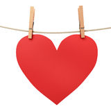 Paper heart attached to a rope clothespin Royalty Free Stock Images