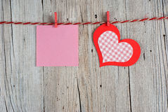 Paper heart and blank note Stock Image