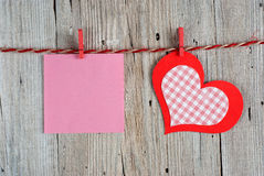 Paper heart and blank note Stock Photos