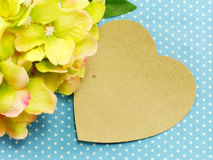 Paper heart on blue polka dot background and beautiful flower Royalty Free Stock Image