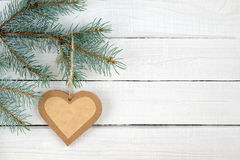 Paper heart and branches of blue spruce Stock Image