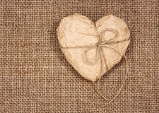 Paper heart on a burlap Stock Photos