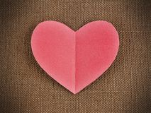 Paper heart on burlap background Stock Photo