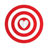 Paper heart in the center of darts target aim. Stock Photos