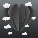 Paper heart and cloud texture on dark background Stock Photo