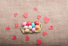 Paper heart and Colorful candy sweets in tray royalty free stock images