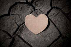 Paper heart on cracked earth Stock Image