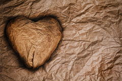 Paper heart on crumpled paper Stock Photos