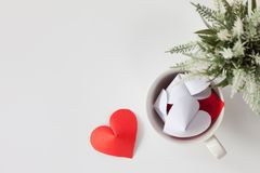 Paper heart in cup of coffee and decorative items. This is the symbol of love. For In February 14th, which was a day of love Stock Photo