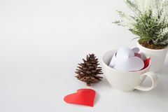 Paper heart in cup of coffee and decorative items. This is the symbol of love. For In February 14th, which was a day of love Royalty Free Stock Photography